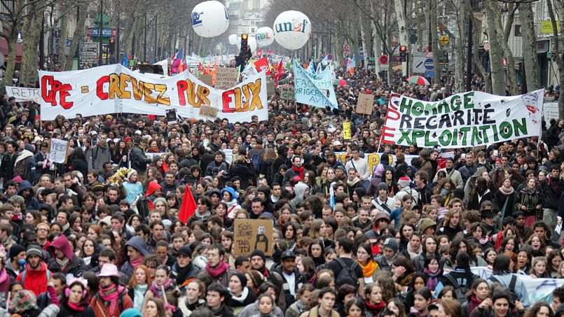 Thousands of people demonstrate 07 March 2006 in Paris during a nationwide protest over the government's youth job plan, the first employment contract (CPE), a permanent work contract for those under 26, which allows an employer to lay off the employee during the first two years of employment. Critics have said it undermines French labour laws and will make it more difficult for young people to find long-term jobs. French Prime Minister Dominique de Villepin finally used a special constitutional power to force the CPE through parliament without a vote, where the opposition had been stalling debate on the text.   AFP PHOTO JACK GUEZ / AFP / JACK GUEZ